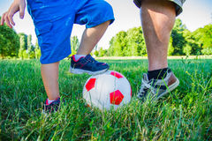 Dad and little boy play with the ball. A Dad and little boy play with the ball stock image