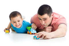 Dad and little child boy playing with toy cars. Daddy and little child boy playing with toy cars royalty free stock images