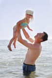 Dad and little daughter  on the beach Royalty Free Stock Images