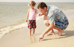 Dad and little daughter  on the beach Stock Photography