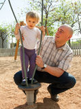 Dad  with little daughter  on  playground. Royalty Free Stock Photos