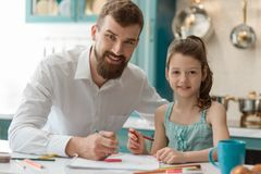 Dad and little daughter. Portrait of smiling dad and little daughter, drawing a picture. Family, bonding activity, spending time together stock image