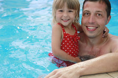 Dad and little daughter in the water pool Royalty Free Stock Images