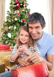 Dad and little girl at Christmas time Stock Photos