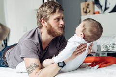 Dad and little son in the bedroom Royalty Free Stock Photos