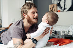 Dad and little son in the bedroom Royalty Free Stock Images
