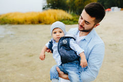Dad with little son in her arms Stock Images