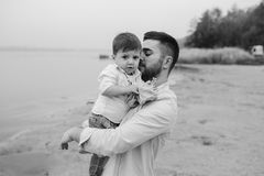 Dad with little son in her arms Royalty Free Stock Photo