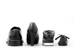 Dad, mam, my brother and me. View of four  shoes (father, mother and two children). Concept of family Stock Image