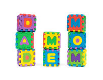 DAD ME MOM shaped by alphabet jigsaw puzzle on white Stock Images