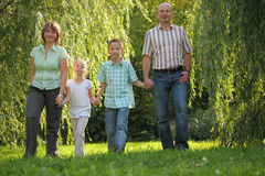 Dad, mom and children is walking in fall park royalty free stock photos