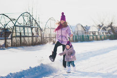 Dad mom and daughter on a background of winter trees and blue sky, lifestyle, winter vacation, fun Royalty Free Stock Photos