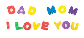 DAD MOM I LOVE YOU shaped by alphabet jigsaw puzzle on white Royalty Free Stock Photography