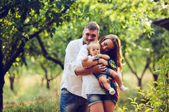 Dad, mom and little girl on the farm Royalty Free Stock Photos