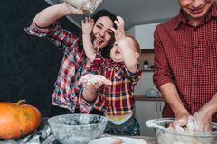 Dad, mom and little son cook a pie Stock Image