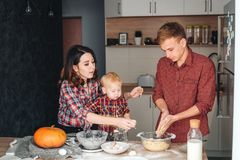 Dad, mom and little son cook a pie Stock Photos