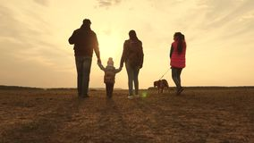 Dad, Mom, a small child and daughters and pets tourists. teamwork of a close-knit family. family travels with the dog on. Dad, Mom, small child and daughters and stock video footage