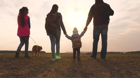 Dad, Mom, a small child and daughters and pets tourists. teamwork of a close-knit family. family travels with the dog on. Dad, Mom, small child and daughters and stock video