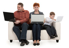 Dad mom and son. With laptop sitting on the couch Royalty Free Stock Photography