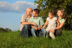 Dad, mom, son and daughter in early fall park Royalty Free Stock Image
