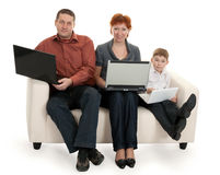 Dad mom and son with laptop. Sitting on the couch Stock Photos
