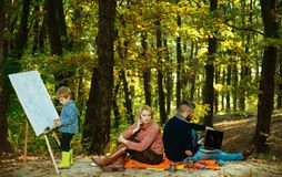 Dad mom and son playing together. Family Camping with kids. We like autumn time together. Happy family having fun in. Autumn park royalty free stock images