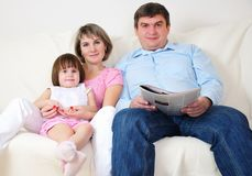Dad, Mom and their little daughter Stock Images