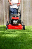 Dad Mowing Yard. This a picture of a man moving the yard on a hot summer day Stock Photo