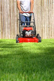 Dad Mowing Yard. This a picture of a man moving the yard on a hot summer day Stock Photos