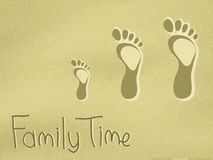 Dad, mum and childs footprints on the sand Stock Images