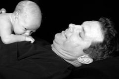 Dad and Newborn baby. A dad holding his newborn son on his chest in black and white Stock Images
