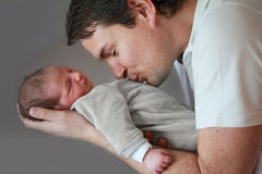 Dad with Newborn Son Stock Images