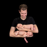 Dad of newborn twin babies Stock Images
