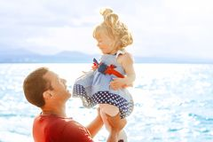 Dad picks up the child royalty free stock image