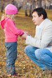 Dad pitying daughter Stock Image