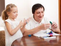 Dad play with girl Stock Photography