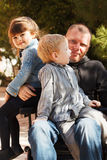 Dad play with son and daughter royalty free stock photography