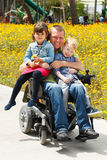 Dad play with son and daughter. Disabled Father play with his little son and daughter royalty free stock photos