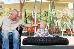 Dad play with son outdoor at park Stock Image