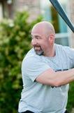 Dad playing backyard baseball Stock Images