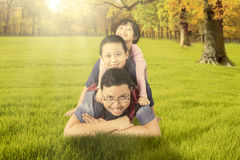 Dad playing with his children at the autumn park Stock Photography