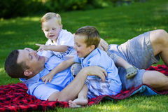 Dad playing with his kids Royalty Free Stock Photos