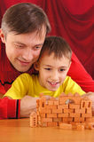 dad playing with son Royalty Free Stock Photos