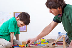 Dad playing with son. Dad playing with his son in playroom Royalty Free Stock Photography