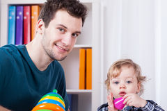 Dad playing with son. Young dad playing with his son, horizontal Stock Images