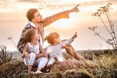 Dad playing with two little cute daughters royalty free stock photo