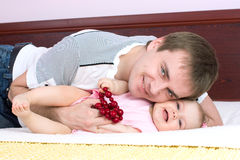 Dad plays with babygirl Stock Image