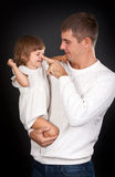 Dad plays with daughter. On a black background stock photo