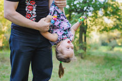 Dad plays with daughter stock photography