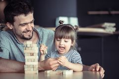Dad plays with his daughter royalty free stock photography